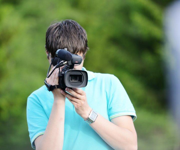 Cameraman filming outdoor